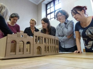 GWL staff explore a model of the Bridgeton Library