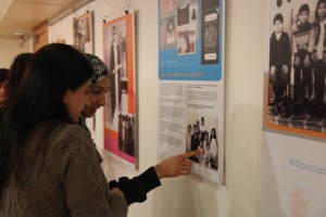 Women look at the She Settles in the Shields exhibition at Community Launch in 2011