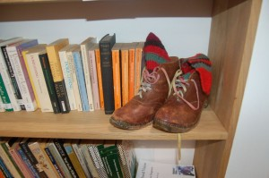 Ros's clogs hiding in the bookshelves at GWL.