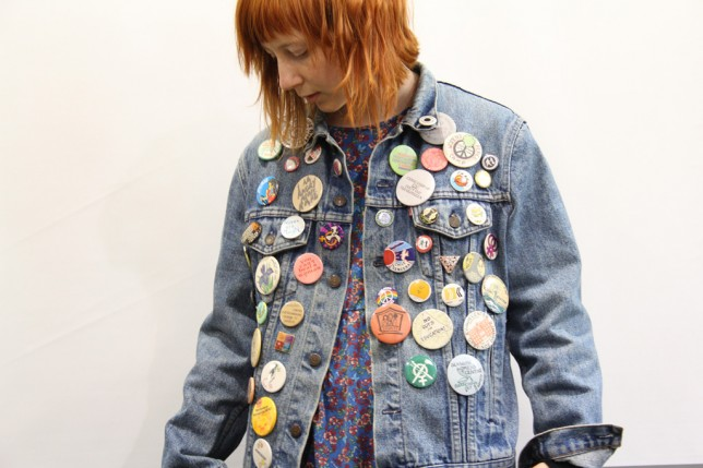 Intern Hannah wearing badges from the GWL collection