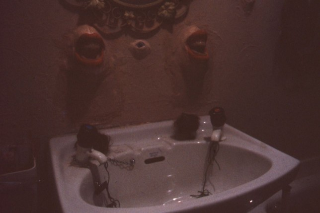Castlemilk Womanhouse participants, Bathroom sink in Haunted House installation, 1990. Image by Rachael Harris, copyright Glasgow Women's Library.