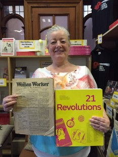 Anne Marie Shields holds up a copy of 21 Revolutions and The Woman Worker which inspired her blog post.