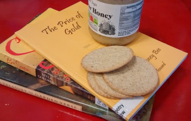 Photo of books, a honey jar and oat cakes.