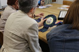 Looking at a rosette, Badges of Honour project