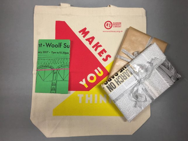 Book Lover's Gift Bundle with a tote bag, two wrapped up books and a notebook covered in a GWL Herland poster