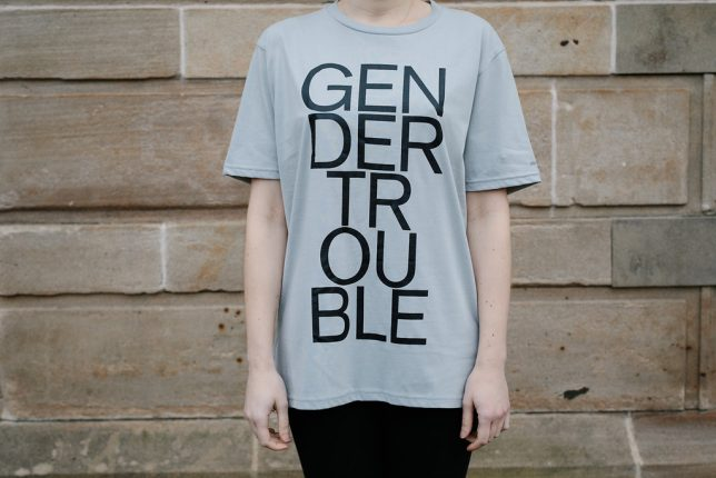 Grey t-shirt with 'Gender Trouble' emblazoned on the front