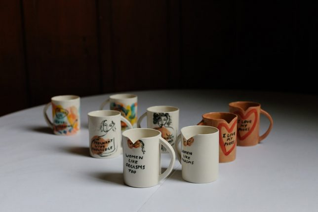 Slogan Mugs all displayed on a table