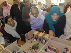 Women working on The Model House