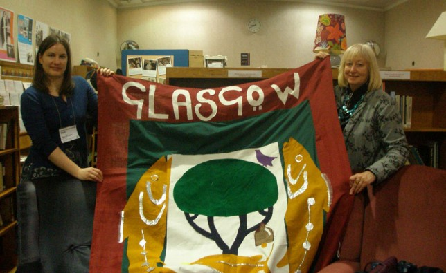 Susan Moffat kindly handing over the Gude Cause banner to our archivist, Hannah Little.