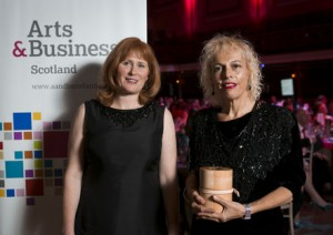 GWL's Adele Patrick accepts the Arts & Business Scotland Enterprising Museum Award 2013-14 from Joanne Orr, CEO of Museums Galleries Scotland.