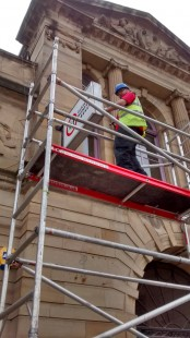 GWL sign being installed at the front of 23 Landressy Street