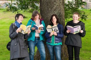 Suffragette Oak With GWL staff and volunteers reading