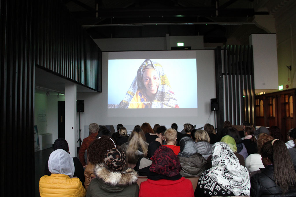 Photo of women at 'I am a Girl' film screening in GWL's events space.