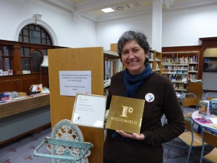 Sue John with the plaque and certificate recording our newly awared status as a Recognised Collection of National Significance