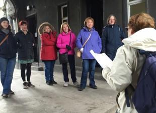Photo of women being spoken to by guide on Women Heritage Walk