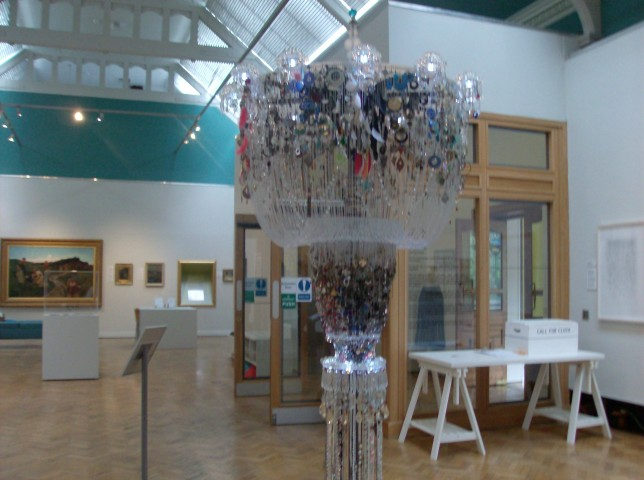 The Chandelier of Lost Earrings in the gallery space (Credit: Mary Alice)