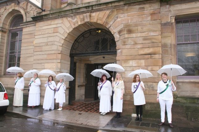 GWL staff welcoming visitors to March of Women