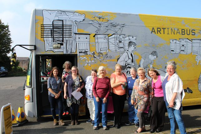 Annan's women's group in front of the Travelling Gallery bus