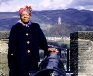Photo of Dr Maya Angelou standing at Stirling Castle with Wallace Monument in the background.