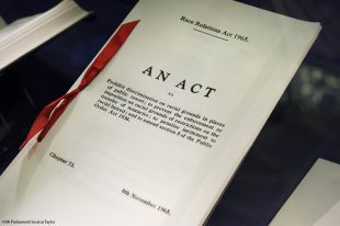 Bound paper showing the words 'An Act' on the cover.
