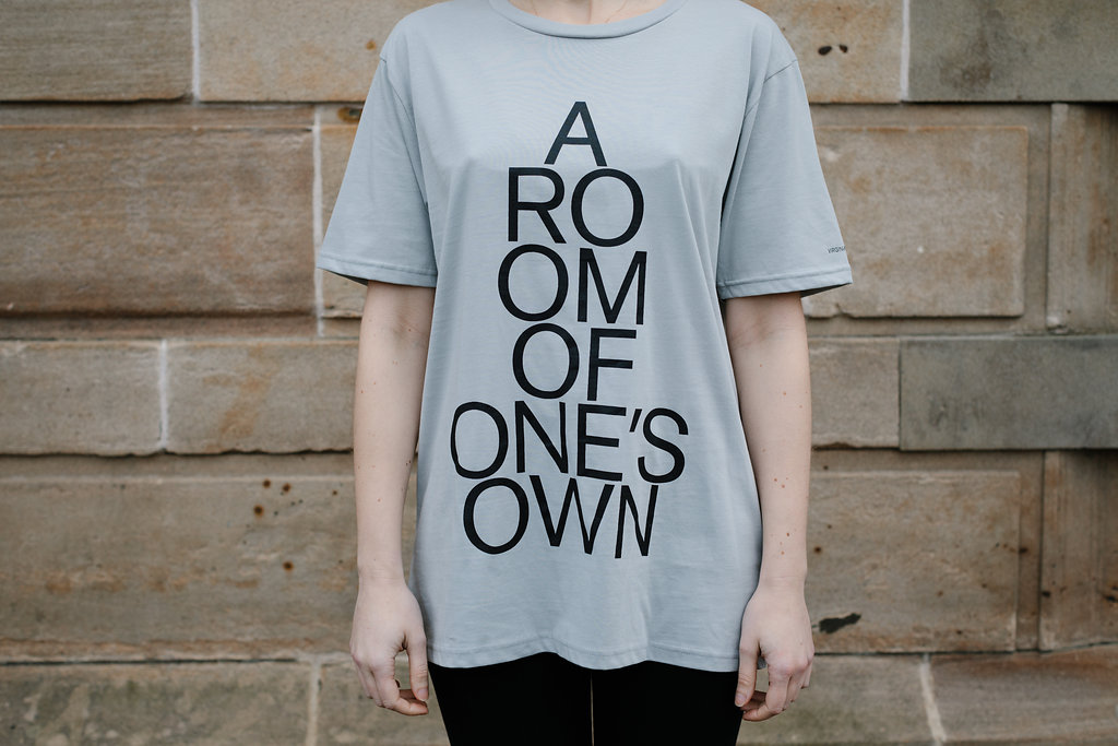 Grey t-shirt with 'A Room of One's Own' emblazoned on the front