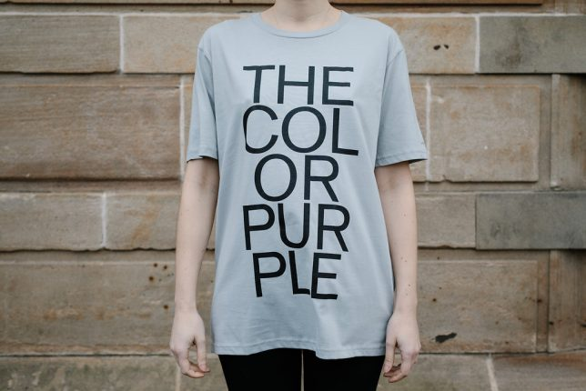 Grey t-shirt emblazoned with 'The Color Purple'