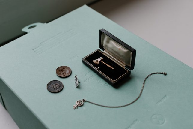 Feminist Charms Archive inspirations including a Carry A Nation Axe pin and a Suffragette Coin