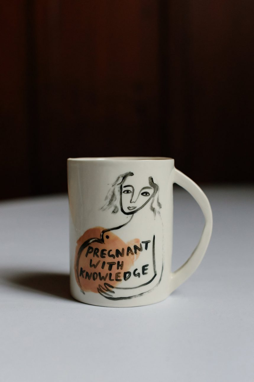 Pregnant with Knowledge Mug. It shows a pregnant figure