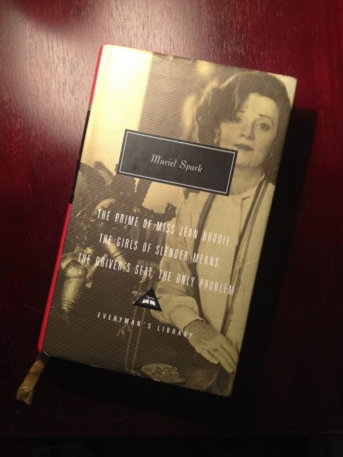 Photograph of the Everyman's Library edition Muriel Spark book mentioned in the blog post. The cover shows a black and white image of a woman, possibly Spark, and the tail end of the yellow ribbon is poking out of the bottom of the book.