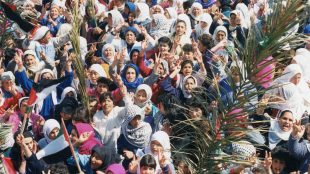 Photograph showing a crowd of Palestinian women on a street rally