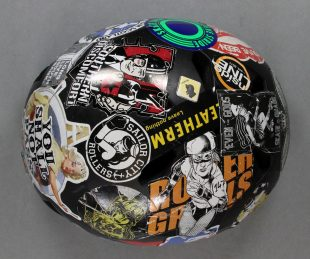 A helmet covered in stickers. From the National Museum of Roller Derby Collection. Credit: GWL.