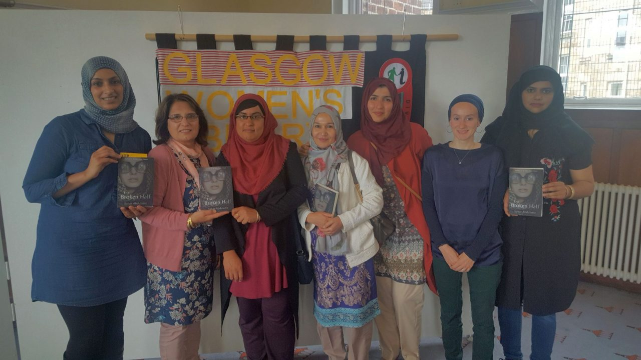 Reading group for Muslim women photographed with the book 'A Broken Half' by Sehar Abdul Aziz. Credit: GWL