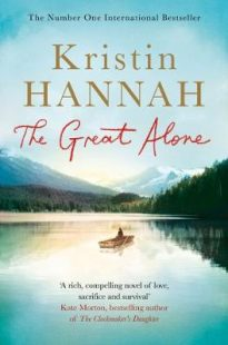 Cover of The Great Alone by Kristin Hannah. A small boat with a single passenger floating on a great lake with mountains rising in the background. Trees surround the lake and cast a shadow on the lake.