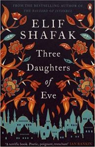 Cover of Three Daughters of Eve. A selection of flowers surround the text and the bottom shows the skyline of, presumably, Istanbul. The colours are blue, red and orange.