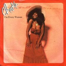 Artwork for the single. Chaka Khan is picture with a red maxi dress which hugs her figure and a large floppy hat.