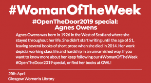 "Red post with white, bold writing that reads ""Open the door special Agnes Owens"""