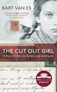 """A black and white picture of a young girl takes up most of the background of the cover. A red strip is painted across the photo with the title written in white. The title reads """"The Cut out firl a story of war and family, lost and found"""". On the bottom of the cover is a letter with a date on it and on the top left corner two stamps."""