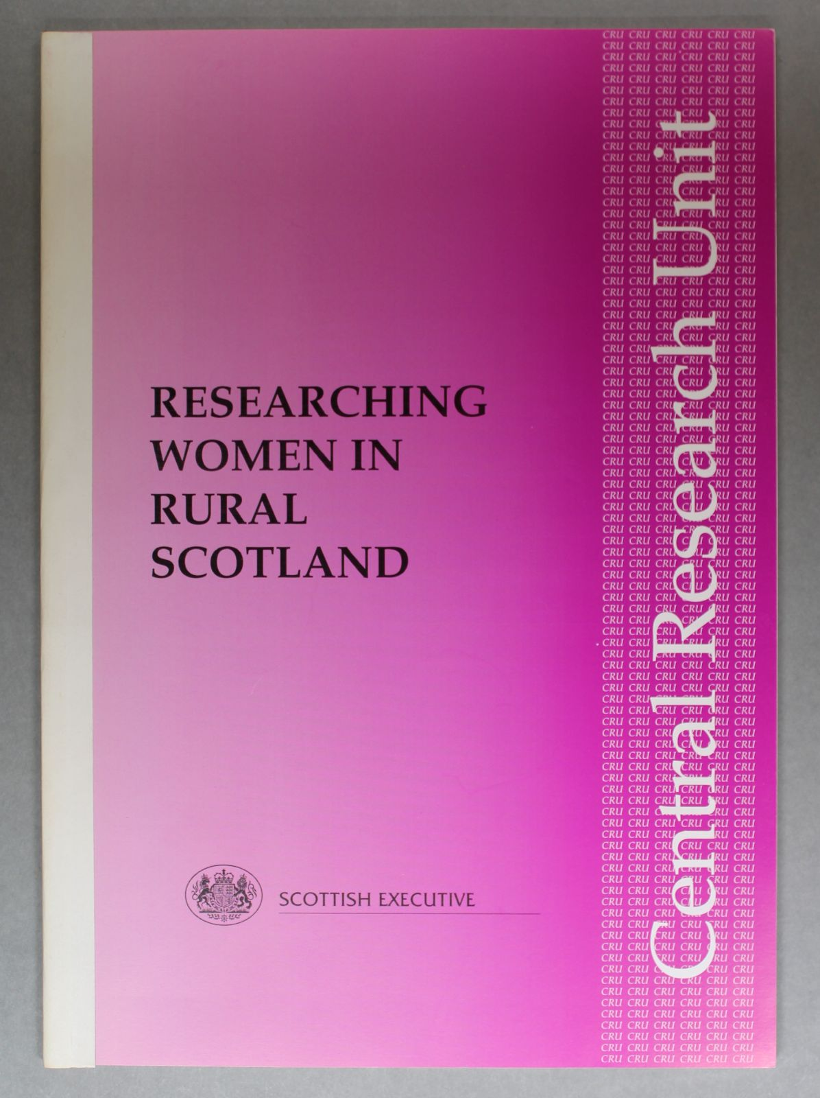 """A pink cover with the title in black capital letters. Along the right-hand side it reads, """"Central Research Unit"""""""