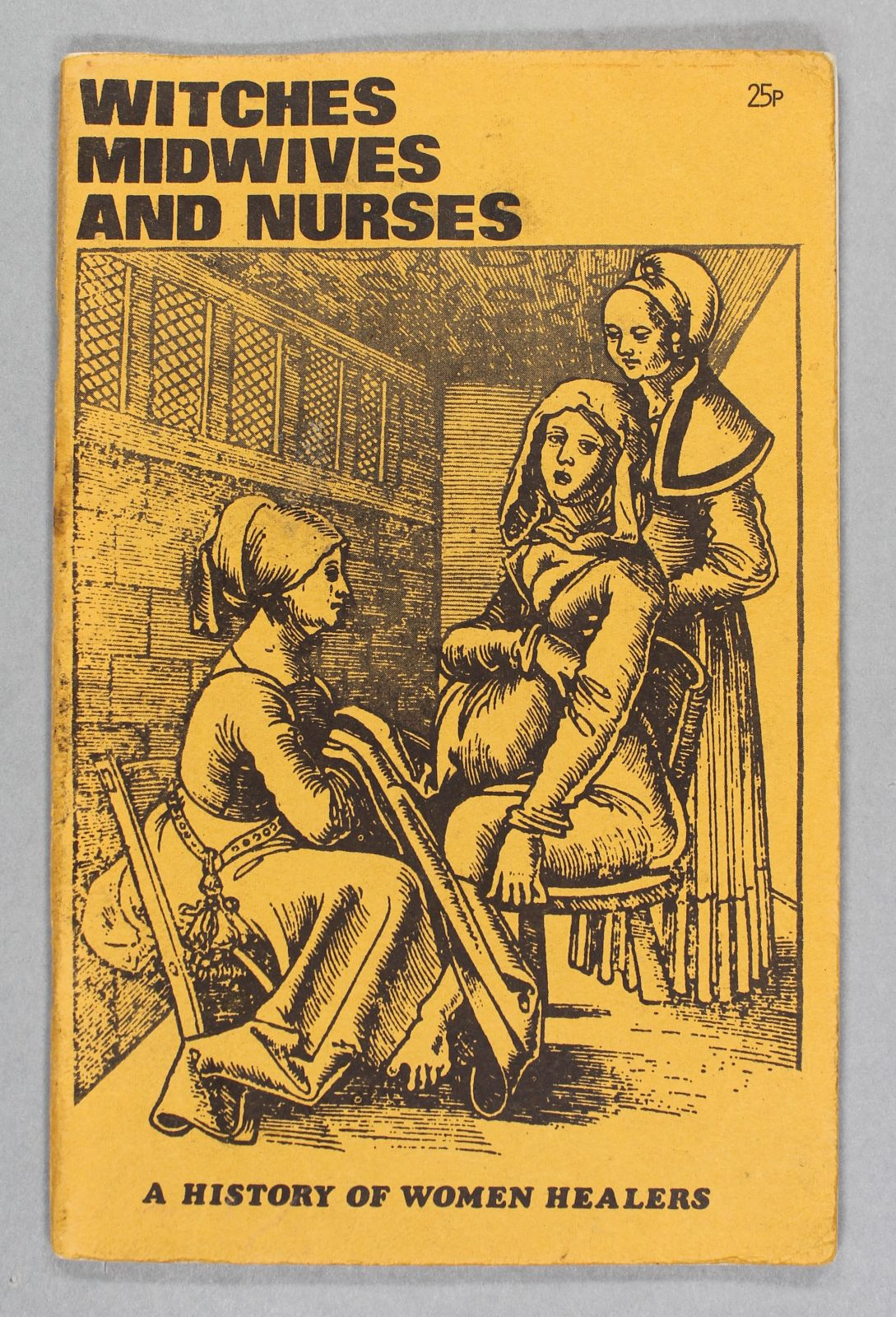 """A yellow book with a black and white illustration showing a woman tending to a woman who is pregnant. At the bottom it says, """"A history of women healers""""."""