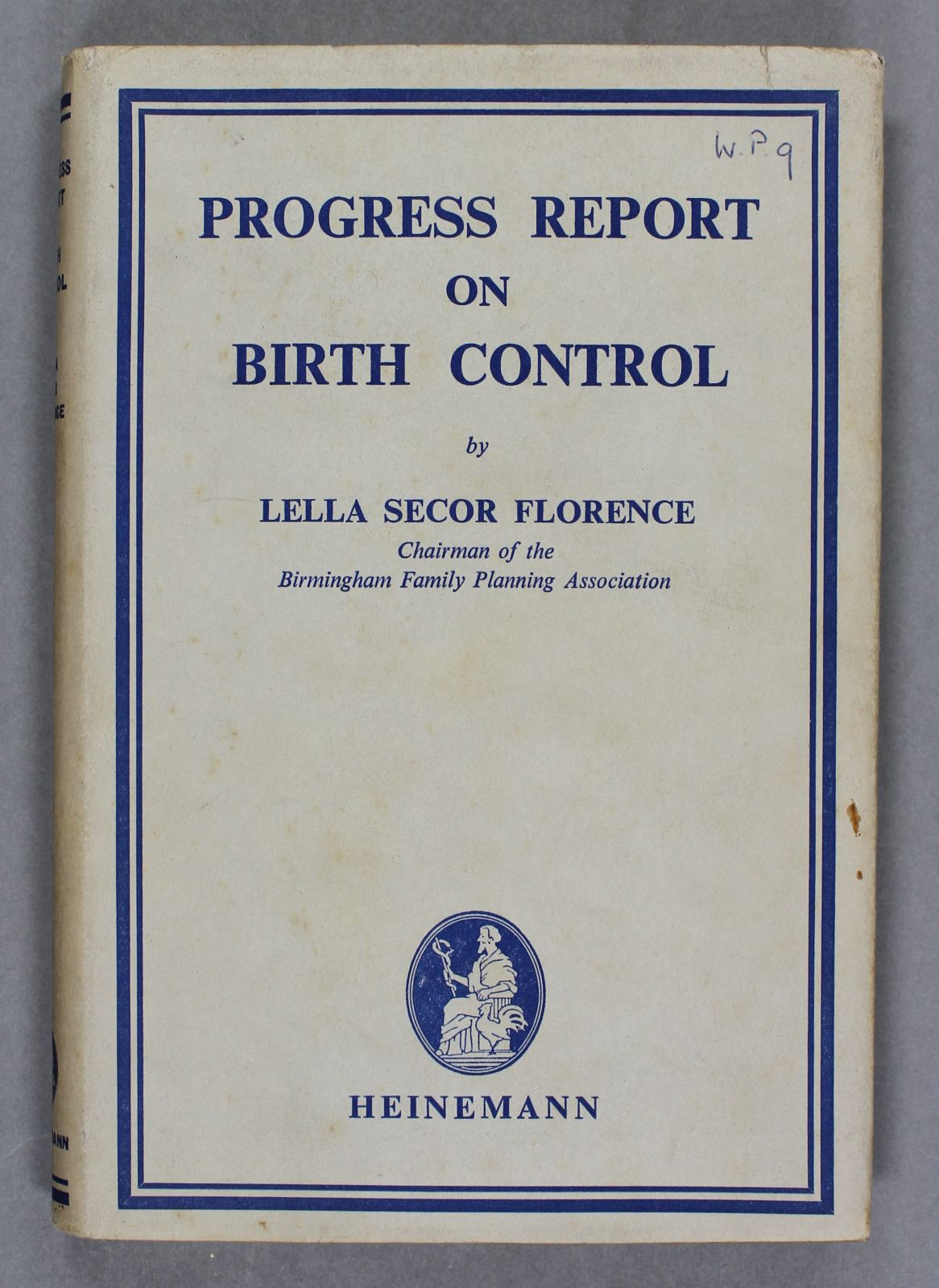 A white book with a slightly worn dust jacket. The title and author name are in blue and a blue box runs around the edges as a design feature.
