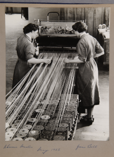 Chrissie Martin and Jessie Bell weaving a Templeton carpet 1955. Credit: STOD201/2/16/1/6 - p.8 University of Glasgow Archives Services