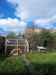 A photograph of a greenhouse. It is at Johnstone Terrace Nature Reserve, Edinburgh's 'Secret Garden', where the creative writing workshops take place