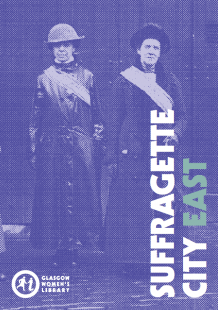 Click to download the Suffragette City East Trail Map (image is the cover of the Suffragette City East Trail Map, featuring two suffragettes in raincoats and sashes)