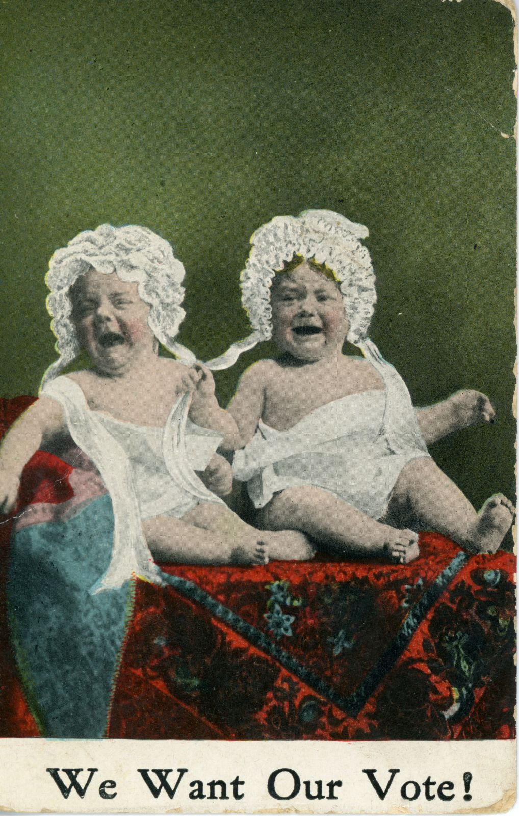 "Anti-suffragette postcard of two infants in lace bonnets heartily bawling, with the caption ""We want our vote!"""