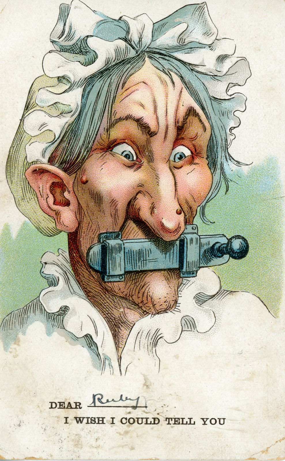 "Postcard with an illustration of an old woman with a bolt shot across her lips. Caption: ""Dear [here there is a space to fill in the name of your choice, in this instance:] Ruby, I wish I could tell you""."