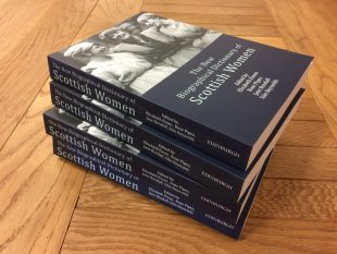 Stack of four New Biographical Dictionary of Scottish Women books on a wooden table.