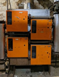 The old boiler! It looks like four orange boxes arranged two on top the other.