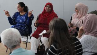 Sakinah Women performing alongside comedian Lubna Kerr during book week Scotland. Credit: GWL