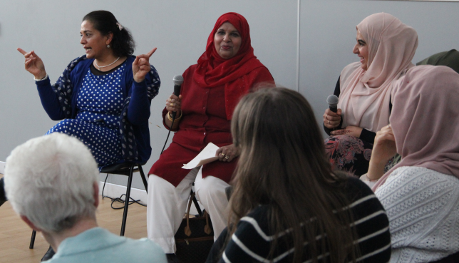 Sakinah Women performing alongside comedian Lubna Kerr during book week Scotland. Credit: GWL