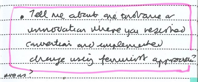 A photograph of a handwritten page from Adele's Clore Fellowship notebook with highlighted text that reads, ' Tell me about one instance or innovation where you resisted convention and implemented change using feminist approaches?'